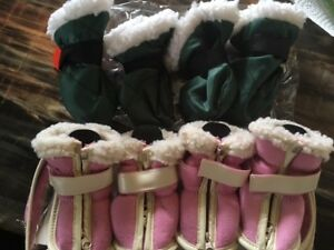 Two pairs of dog boots size medium