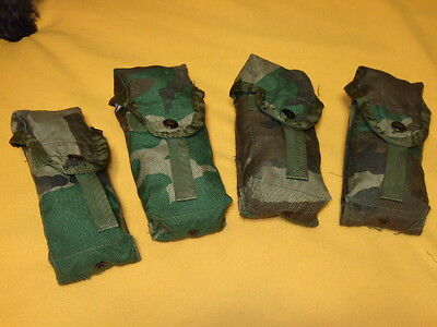 CLIP POCKETS,( 4 ) WOODLAND CAMO , ATTACHES TO MOLLE OR ALICE PACKS AND BELT