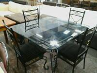 Black and gold metal w/glass table and 4 chairs