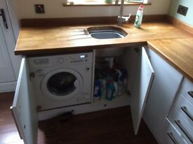 White high gloss kitchen for sale, solid oak work tops including integrated appliances.