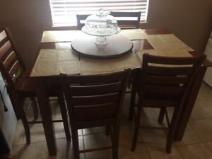 Solid wood kitchen table with high chairs - $500 (Surrey)