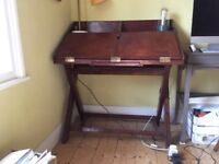 Handsome leather desk, real leather throughout, huge working space when opened, compact when closed