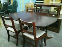 Rosewood dining table and 4 chairs
