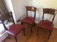 Four solid dining chairs