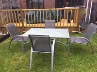 Glass rectangle table with four chairs (parasol to match if desired extra £10)