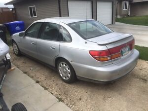 must sell 02 Saturn safetied lowkms clean title