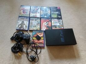 Playstation 2 with accessories and games
