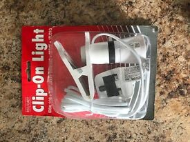 Portable clip on light for sale
