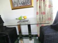 Glass Dining Table and Four Leather Look High Backed Chairs - 100 Pounds