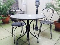 Elegant setting of table and chairs for the outdoors