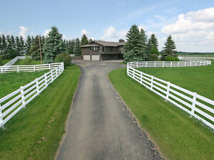 CUSTOM BUILT walkout bungalow - 6.99 acres - minutes from Edmt.