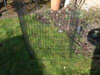 Metal panel animal pen for puppies, rabbits.