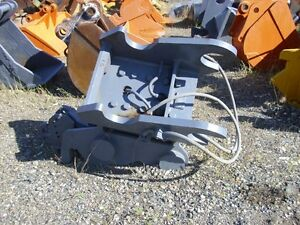 Helac tilt head for 250 size excavator. 250-573-5733 Kelsey