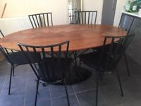 Oval Dining table with interesting metal base and 6 metal chairs