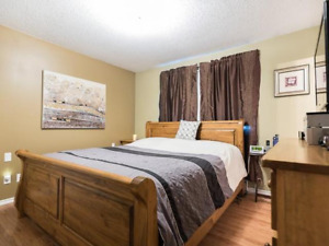 Furnished bedroom in a beautifully renovated home in Riverdale