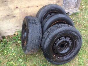 Four 215/70/R15 Michelin's tires, Chrysler rims, never used