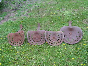 4 antique implement / tractor seats .