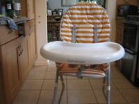 MOTHERCARE FOLDING HIGHCHAIR IN VERY GOOD CONDITION, VERY EASY TO WIPE CLEAN.