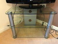 2 x TV Stands. 1 glass, 3 tier. 1 Wood effect w/ sliding front door (from Argos)
