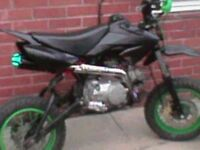 Pitbike 125 no kick start runs good bike just needs new back weel bar fast bike for a 125 info ring