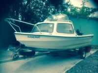 Dejon 14 day boat with 4 stroke outboard, trailer, canopy. Good condition ready for launching