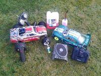 2 radio controlled nitro cars
