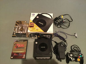 NINTENDO GAMECUBE WITH ZELDA GAMES AND A GOLDN LINK TOY