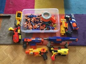 Assortment of Nerf guns and bullets