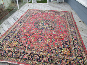 Looking for a red antique Persian Rug