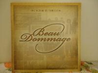 ALBUM DE FAMILLE BEAU DOMMAGE FLAMBANT NEUF...(5) C.D ET (2) DVD