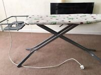 Ironing board with plug lead