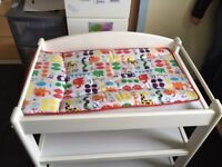 Baby changing table with storage and change mat