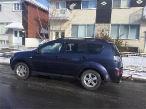 2009 MITSUBISHI OUTLANDER- awd-  4 CYLINDRES-**  PROPRE-  4000$
