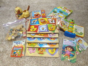Puzzles, Books, Fisher Price Dog, etc. Box full of toys