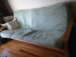 Comfy double-sized futon with washable cover.