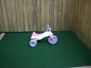 Pink tricycle for girl