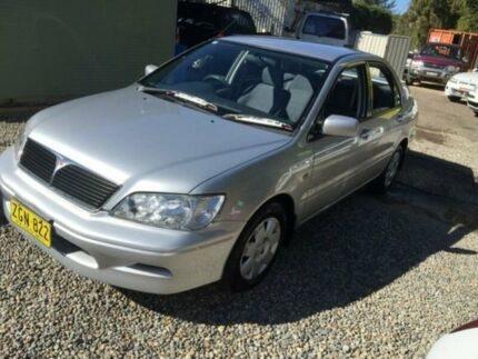 2003 Mitsubishi Lancer CH LS Silver 4 Speed Automatic Sedan Jewells Lake Macquarie Area Preview