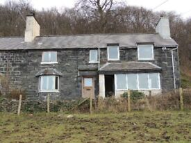 Two storey mid-terrace stone house with two bedrooms, rural location, parking, solid fuel heating