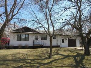 Curb appeal with 2+1 BR home on double corner lot in Strathclair