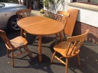 Oak kitchen table + 4 matching chairs