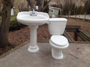 Ornate ceramic matching sink/toilet