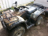 2007 camouflage Quad for trade.
