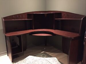 Complete computer desk with above shelving unit and table.