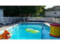 Entertain family & friends in this updated home, with a pool!