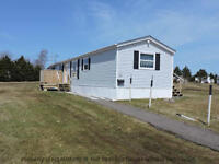 Extremely well maintained mini home on a great lot!