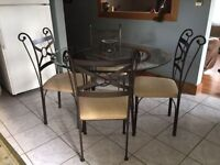 Iron glass top dining table with 4 chairs