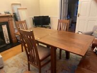 Oak dining room table and 4 matching chairs
