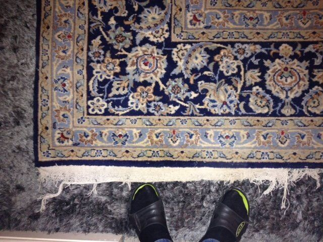 Beautiful used Persian carpet. Very large. Slight damage in one corner