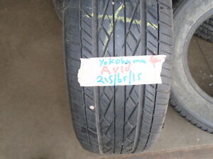 FOUR USED ALL SEASON TIRES  215-65-15 { YOKOHAMA } R.H AUTO
