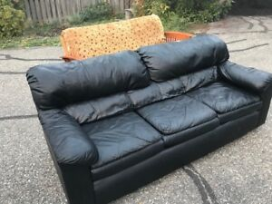 Faux leather black couch in good condition